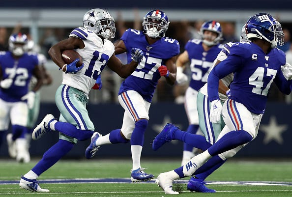 Michael Gallup runs through the Giants defense in Week 1.