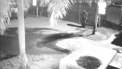Florida man in garbage-bag 'suit' sets fire to trash trucks