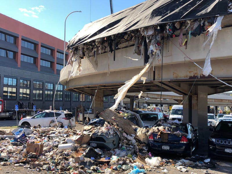 Garbage spills on parked cars in Buffalo