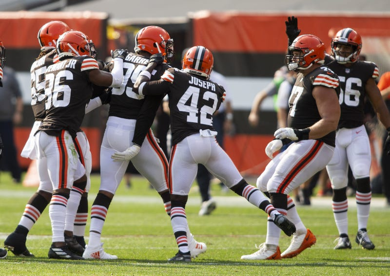 Cleveland Browns defensive end Myles Garrett celebrates his fumble recovery with cornerback M.J. Stewart and strong safety Karl Joseph against the Washington Football Team during the fourth quarter at FirstEnergy Stadium. The Browns won 34-20.