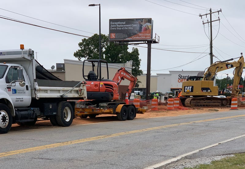 Piedmont Natural Gas workers repair gas leak caused by road construction crew.