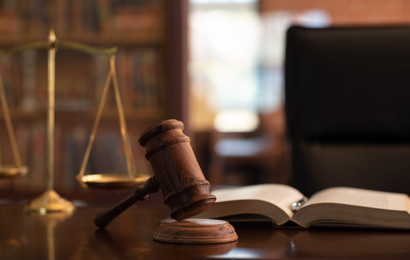 judge gavel, law books and scales of justice on desk