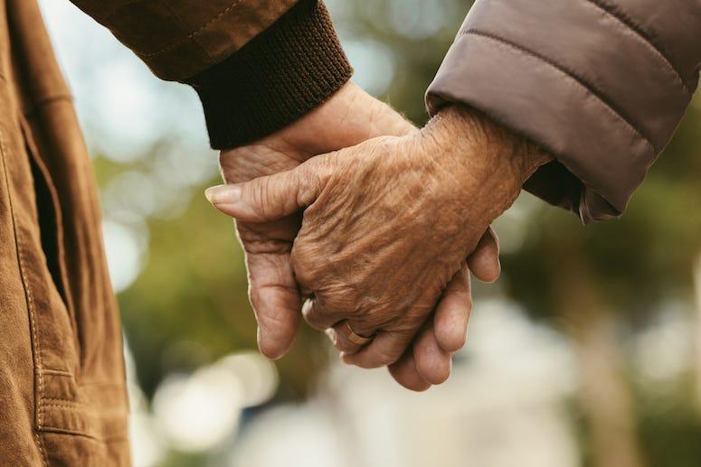 Elderly Couple, Holding Hands, Walking, Outdoors