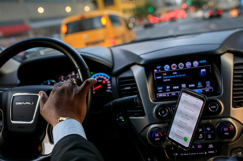 After dropping off passengers at a Broadway play, Johan Nijman, a for-hire driver who runs his own service and also drives for Uber on the side, drives through the West Side of Manhattan on Wednesday evening, August 8, 2018 in New York City.