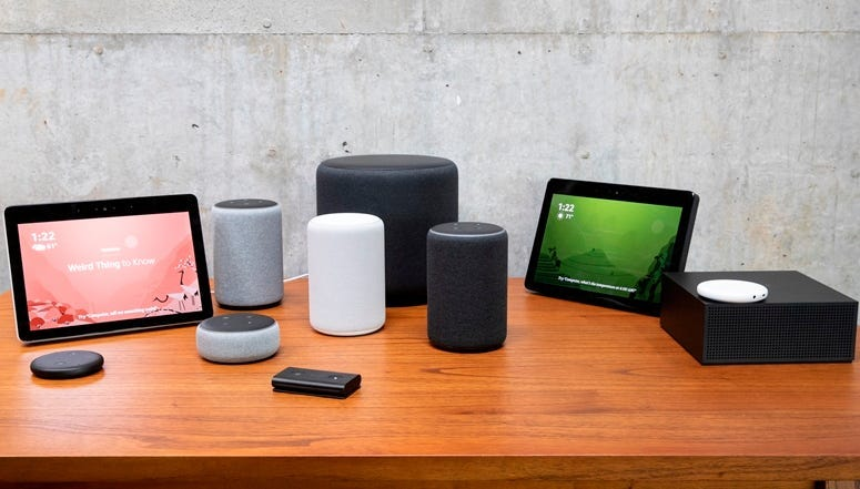 "SEATTLE, WA - SEPTEMBER 20: An assortment of newly launched devices, including, an ""Echo Input,"" ""Echo Show, ""Echo Plus,"" ""Echo Sub,"" ""Echo Auto"" and ""Firetv Recast"" are pictured at Amazon Headquarters, following a launch event, on September 20, 2018 in S"