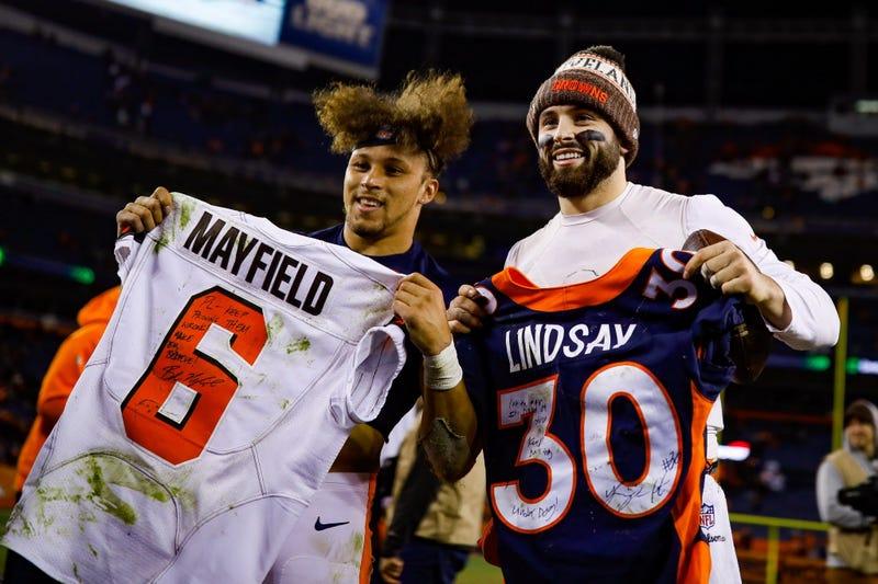 DENVER, CO - DECEMBER 15: Running back Phillip Lindsay #30 of the Denver Broncos and quarterback Baker Mayfield #6 of the Cleveland Browns stand with exchanged jerseys after a game at Broncos Stadium at Mile High on December 15, 2018 in Denver, Colorado.