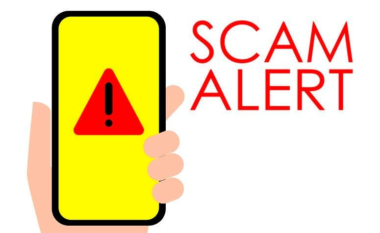 Illustration of Scam Alert Hand holding a mobile phone with scam alert sign