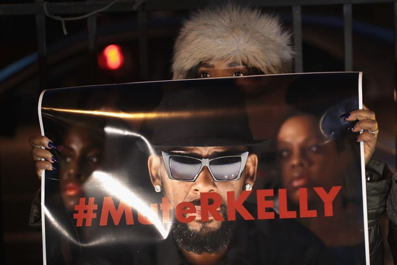 "Demonstrators gather near the studio of singer R. Kelly to call for a boycott of his music after allegations of sexual abuse against young girls were raised on the highly-rated Lifetime mini-series ""Surviving R. Kelly"" on Jan. 9, 2019 in Chicago, Illi"