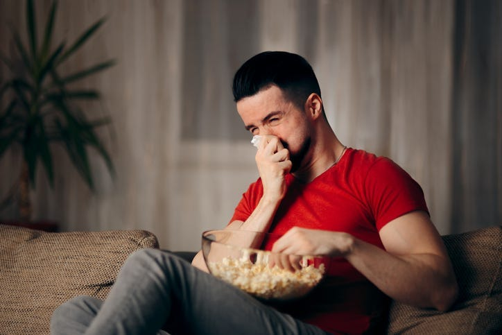 Man Crying While Watching a Movie