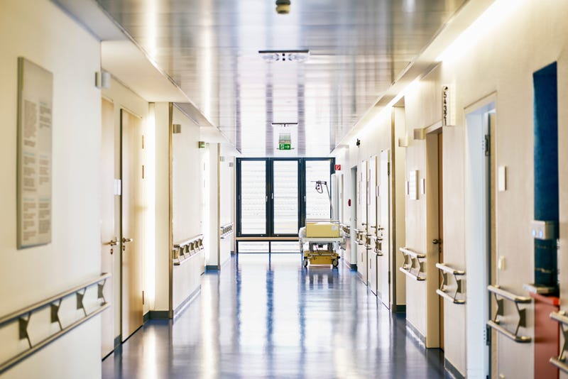 Hospital with corridor and bed without persons in landscape format