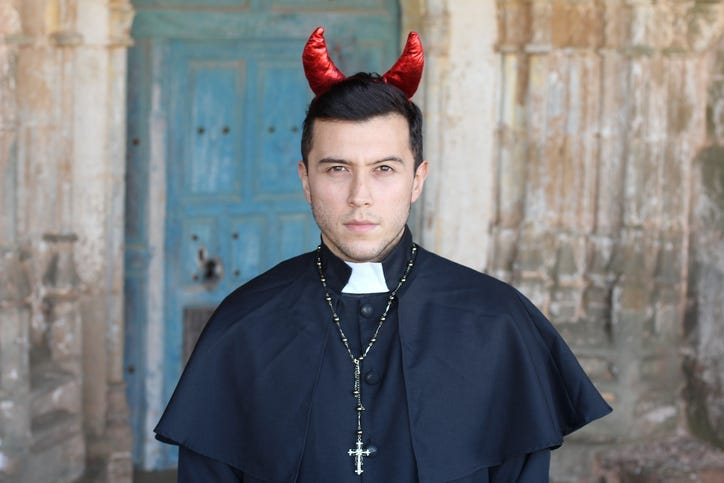 Evil looking priest with horns.