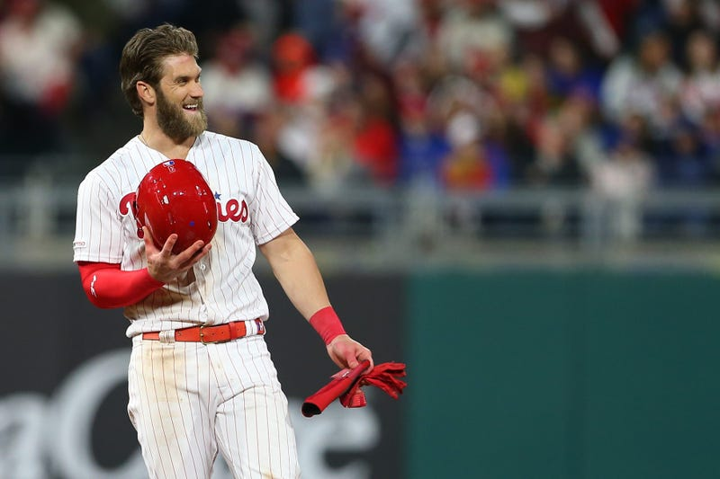 Bryce Harper, #3 of the Philadelphia Phillies, smiles after advancing to second base on a ball off the bat of J.T. Realmuto that was misplayed by third baseman J.D. Davis of the New York Mets, Citizens Bank Park on April 16, 2019.