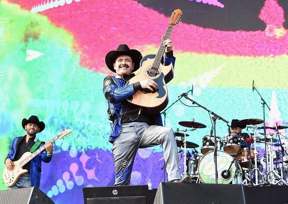 Mario Quintero Lara (C) and David Servin Raya (R) of Los Tucanes de Tijuana perform at Coachella Stage during the 2019 Coachella Valley Music And Arts Festival on April 19, 2019 in Indio, California.