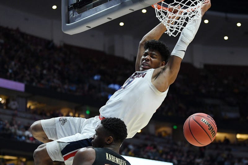 Rui Hachimura dunks on Mfiondu Kabengele of Florida State during the 2019 NCAA Men's Basketball Tournament