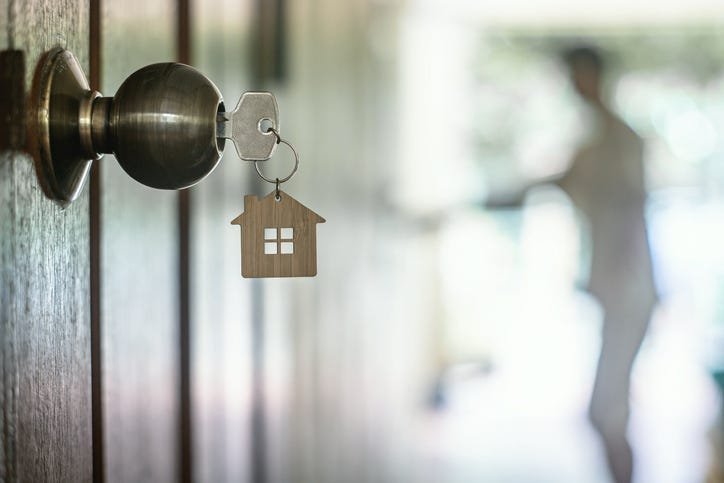 House key with home keyring in keyhole