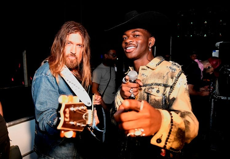 INDIO, CALIFORNIA - APRIL 28: Billy Ray Cyrus (L) and Lil Nas X pose backstage during the 2019 Stagecoach Festival at Empire Polo Field on April 28, 2019 in Indio, California.