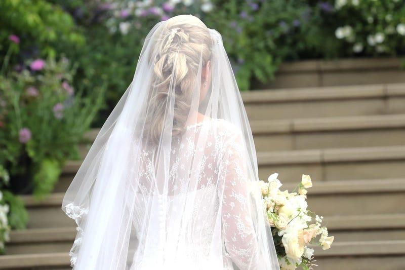 A bride walks down the aisle at an undated wedding.