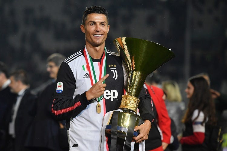 Cristiano Ronaldo of Juventus celebrates during the awards ceremony after winning the Serie A Championship during the Serie A match between Juventus and Atalanta BC on May 19, 2019 in Turin, Italy.