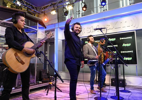 Adrian Gloria, Adrian Zamarripa, Israel Oviedo and Manuel Borrego of La Energia Nortena perform on SiriusXM's Aguila Channel at the SiriusXM Studios on May 23, 2019 in New York City.