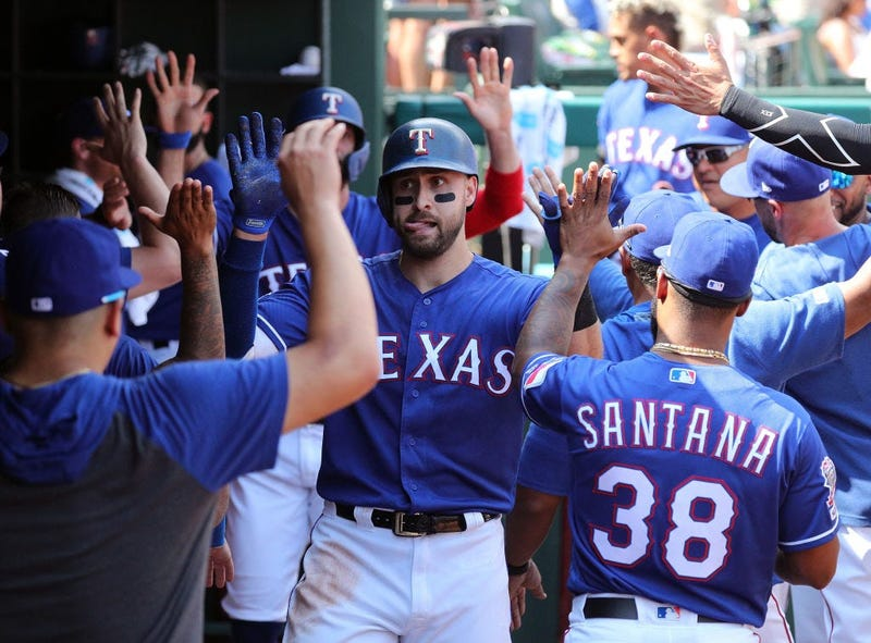 oey Gallo #13 of the Texas Rangers is greeted in the dugout after a two-run home run against the Kansas City Royals in the fourth inning at Globe Life Park in Arlington on June 01, 2019.