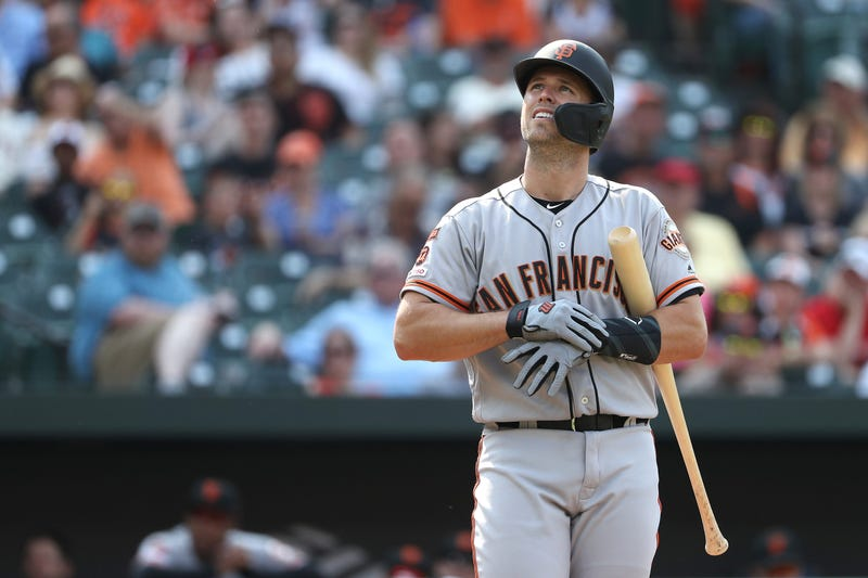 Buster Posey #28 of the San Francisco Giants looks on before batting against the San Francisco Giants at Oriole Park at Camden Yards on June 1, 2019 in Baltimore, Maryland.