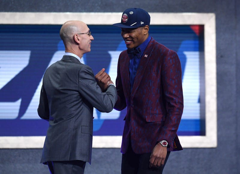 Rui Hachimura poses with NBA Commissioner Adam Silver after being drafted with the ninth overall pick by the Washington Wizards during the 2019 NBA Draft at the Barclays Center