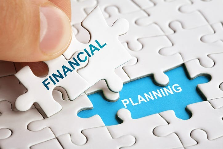 Piece of puzzle with words Financial Planning.