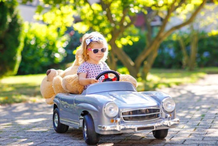 Kid Driving a Car