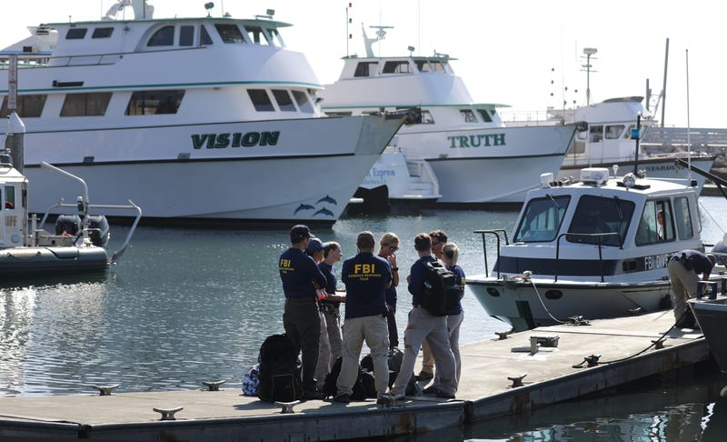 FBI personnel stand on a jetty in front of the ships Vision (L) and Truth, sister vessels of the diving ship Conception, in Santa Barbara Harbor on September 4, 2019 in Santa Barbara, California.