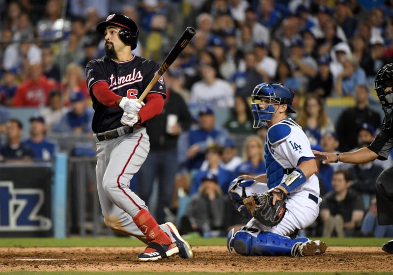 Anthony Rendon of the Washington Nationals hits a double in the tenth inning of game five of the NLDS.