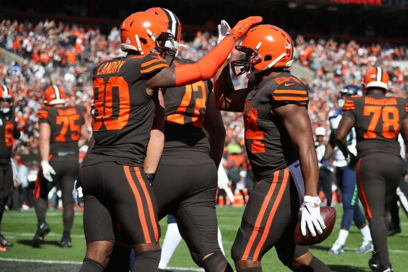 Nick Chubb #24 of the Cleveland Browns celebrates his first quarter touchdown with Jarvis Landry #80 while playing the Seattle Seahawks at FirstEnergy Stadium on October 13, 2019 in Cleveland, Ohio.