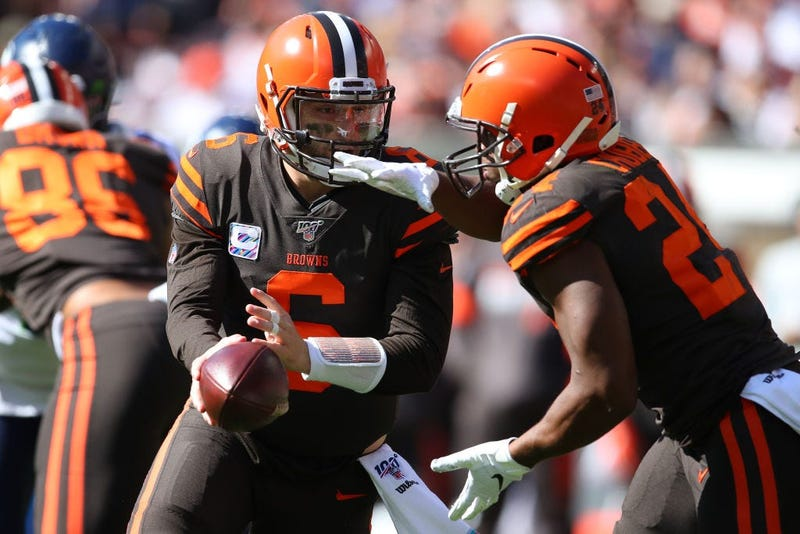 CLEVELAND, OHIO - OCTOBER 13: Baker Mayfield #6 of the Cleveland Browns hands off to Nick Chubb #24 for a second quarter run while playing the Seattle Seahawks at FirstEnergy Stadium on October 13, 2019 in Cleveland, Ohio. (Photo by Gregory Shamus/Getty I