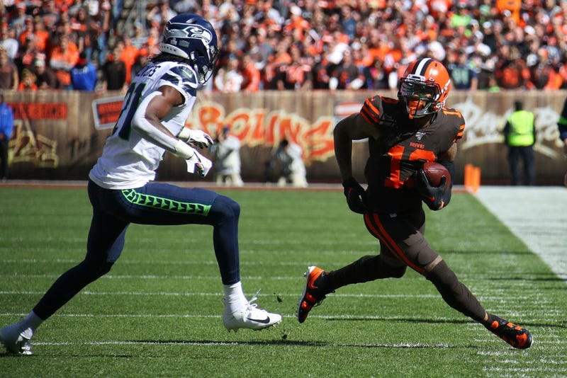CLEVELAND, OHIO - OCTOBER 13: Odell Beckham #13 of the Cleveland Browns looks for yards after a first quarter catch next to Tre Flowers #21 of the Seattle Seahawks at FirstEnergy Stadium on October 13, 2019 in Cleveland, Ohio. (Photo by Gregory Shamus/Get