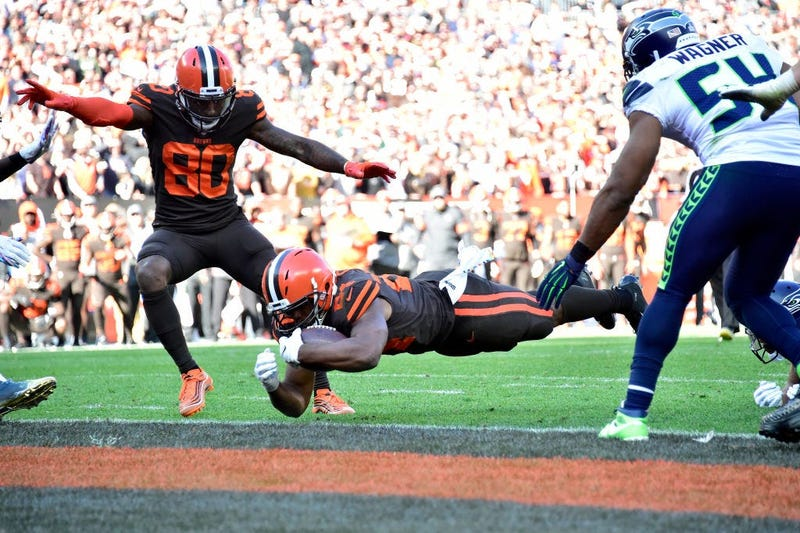 CLEVELAND, OHIO - OCTOBER 13: Jarvis Landry #80 watches as Nick Chubb #24 of the Cleveland Browns scores during the second half against the Seattle Seahawks at FirstEnergy Stadium on October 13, 2019 in Cleveland, Ohio.