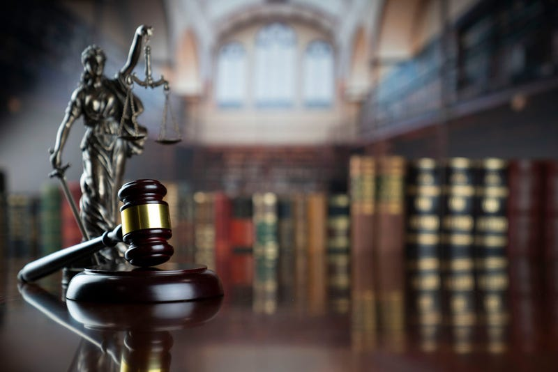 Themis statue, judge gavel and scale of justice