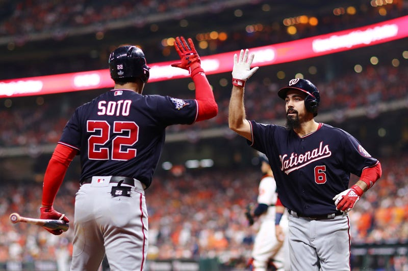 Anthony Rendon is congratulated by his teammate Juan Soto after hitting a two-run home run.