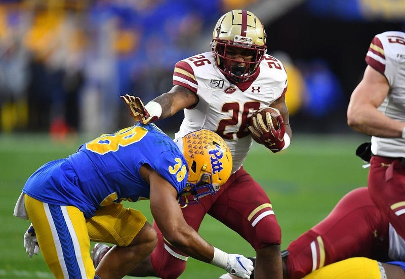 PITTSBURGH, PA - NOVEMBER 30: David Bailey #26 of the Boston College Eagles carries the ball in front of Cam Bright #38 of the Pittsburgh Panthers in the first quarter at Heinz Field on November 30, 2019 in Pittsburgh, Pennsylvania.