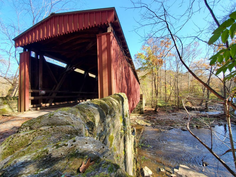 This covered bridge is located along forbidden drive and crosses Wissahickon Creek in the Wissahickon Valley Park in Philadelphia Pennsylvania.