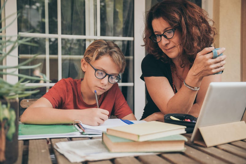 Child being taught at home through distance learning