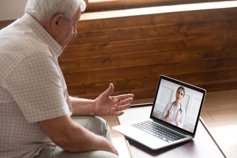 Elderly man using telemedicine