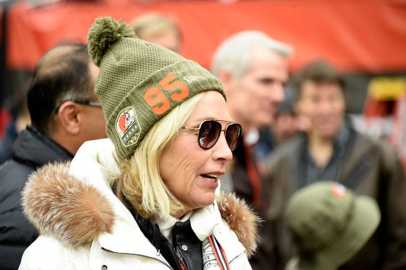 CLEVELAND, OHIO - NOVEMBER 24: Team owner Dee Haslam of the Cleveland Browns talks with guests on the sidelines while wearing a hat supporting defensive end Myles Garrett #95 prior to the game against the Miami Dolphins at FirstEnergy Stadium on November