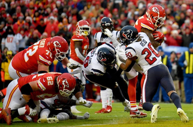Damien Williams #26 of the Kansas City Chiefs rushes for a touchdown over Justin Reid #20 of the Houston Texans in the third quarter of the AFC Divisional playoff game at Arrowhead Stadium on January 12, 2020 in Kansas City, Missouri.