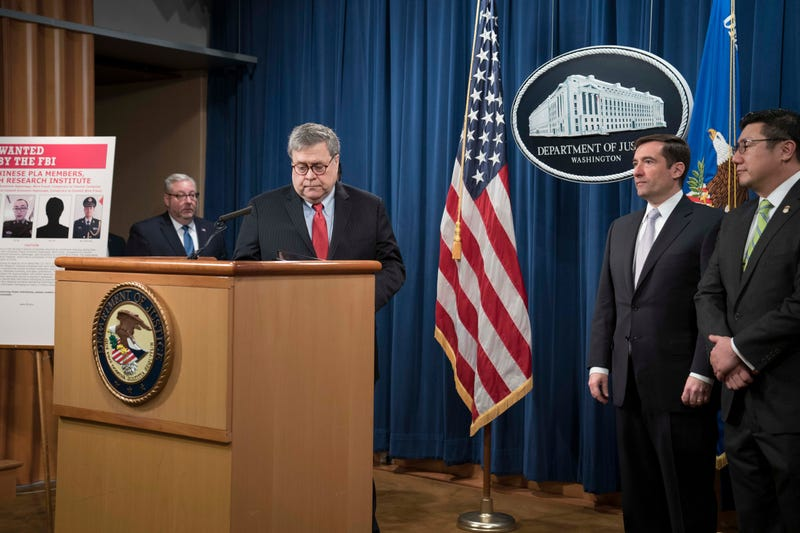 Attorney General William Barr arrives to a press conference at the Department of Justice along with DOJ officials on February 10, 2020 in Washington, DC.