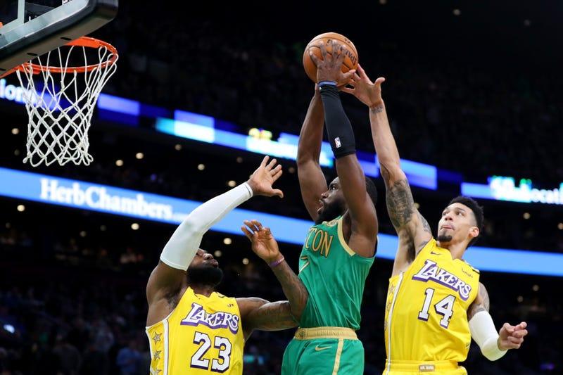 Jaylen Brown dunks on LeBron James