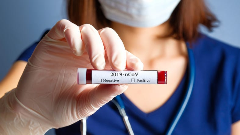 Nurse holding test tube with blood for 2019-nCoV analyzing
