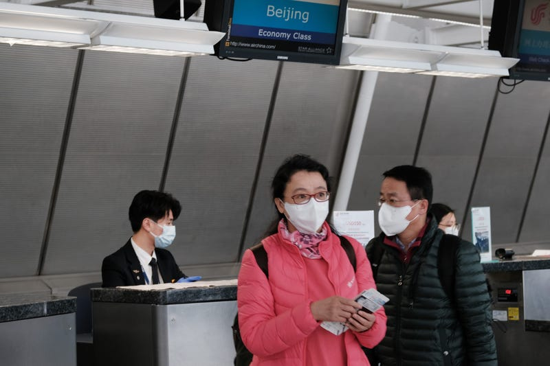 At the terminal that serves planes bound for China, people wear medical masks at John F. Kennedy Airport (JFK) out of concern over the Coronavirus on January 31, 2020 in New York City.