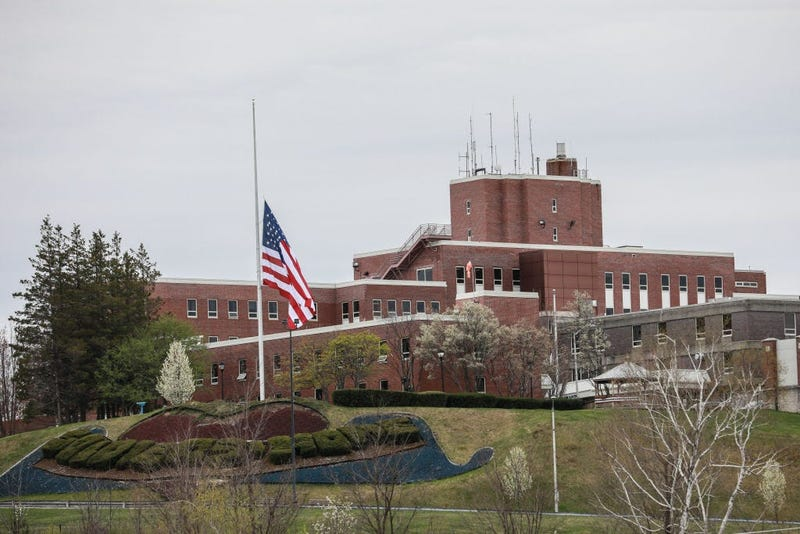 An American flag flies at half-mast outside the Holyoke Soldiers' Home on April 29, 2020 in Holyoke, Massachusetts. In one of the deadliest known COVID-19 outbreaks at a long-term care center in the U.S.