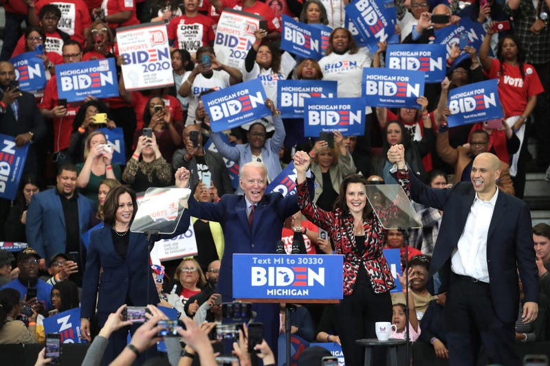 Sen. Kamala Harris (L) (D-CA), Sen. Cory Booker (R)(D-NJ), and Michigan Governor Gretchen Whitmer join Democratic presidential candidate former Vice President Joe Biden on stage at a campaign rally at Renaissance High School on March 09, 2020 in Detroit.