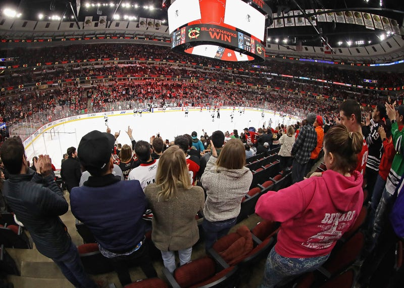 Fans cheer after the Chicago Blackhawks beat the San Jose Sharks at the United Center on March 11, 2020 in Chicago, Illinois.