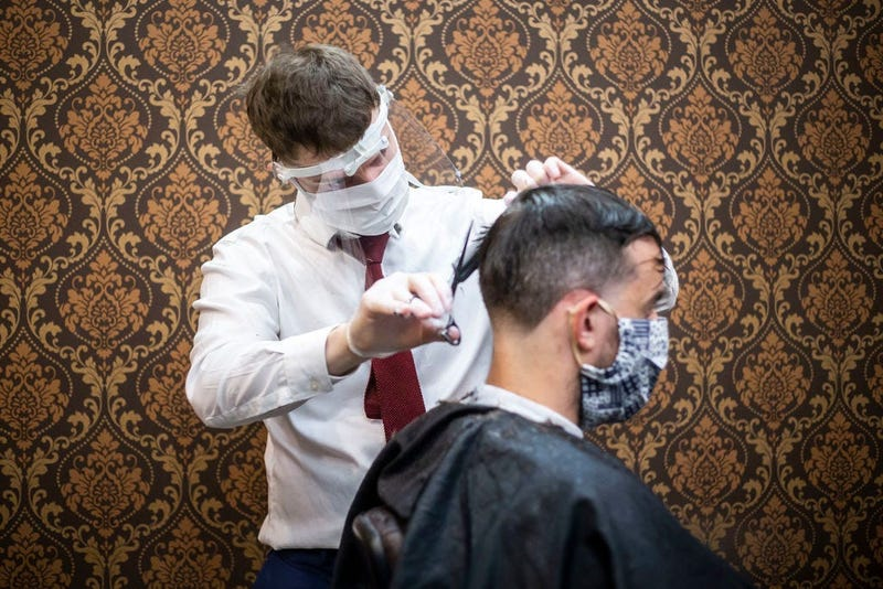 Barber wearing protective gear